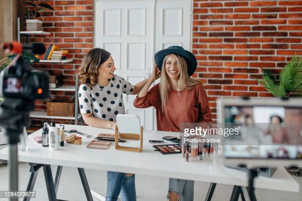 two best friends vlogging about make up - marketing stock pictures, royalty-free photos & images
