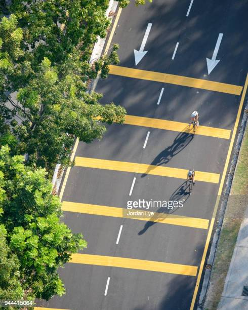 two bicycle racing - following arrows stock pictures, royalty-free photos & images