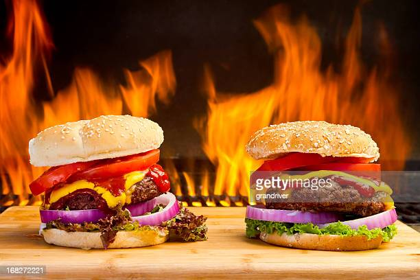 two big cheeseburgers with pretty flames - garnish stock pictures, royalty-free photos & images