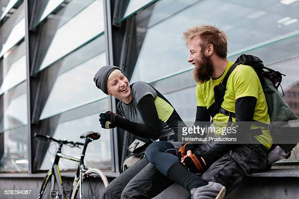 Two Bike Messengers Having A BReak