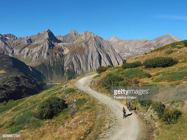 Two Bikers In Formazza Valley, Northern Italy