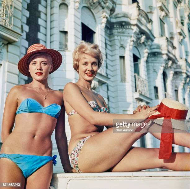Two bikiniclad holidaymakers posing outside the Carlton Hotel in Cannes in the south of France 1958