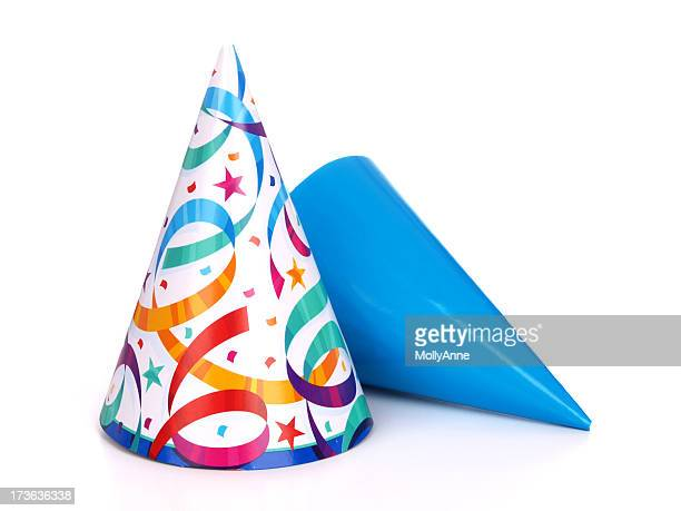 two birthday party hats one blue and the other multicolored - hat stock pictures, royalty-free photos & images