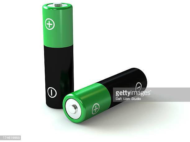 Two black and green AA batteries