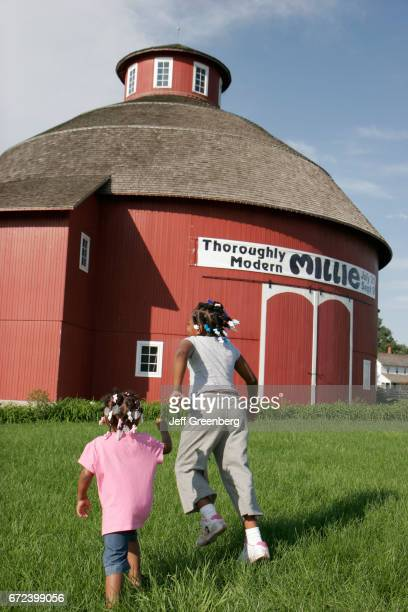 Two black girls running at Amish Acres Historic Farm Round Barn Theatre