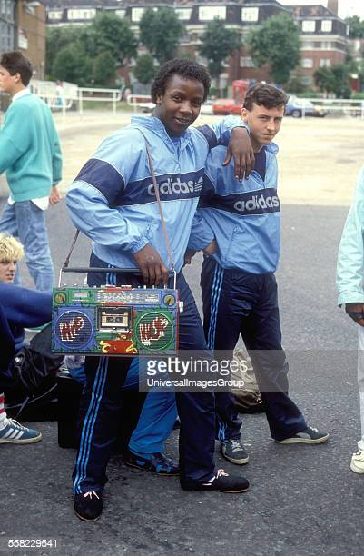 Two black teenagers dressed in Adidas tracksuits with a heavilycustomised ghetto blaster at UK Fresh Hip Hop event UK 1986
