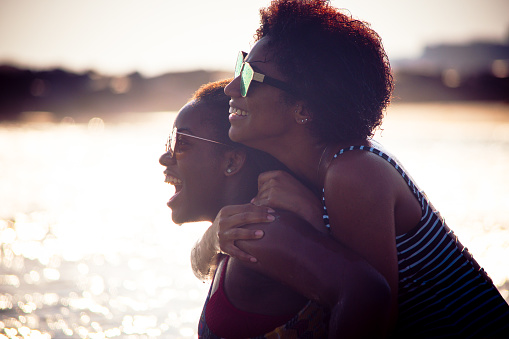 Two black women at the beach together. - gettyimageskorea