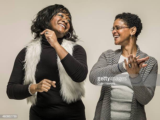 two black women dancing together - colin hawkins stock pictures, royalty-free photos & images