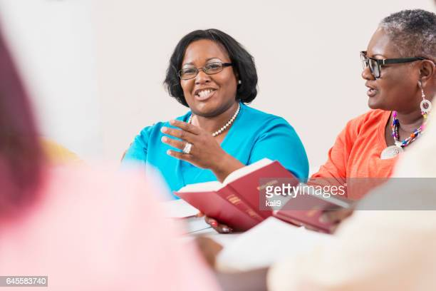 Two black women in bible study group