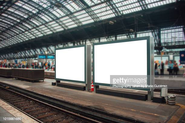 two blank billboards at railroad station - copy space stock-fotos und bilder