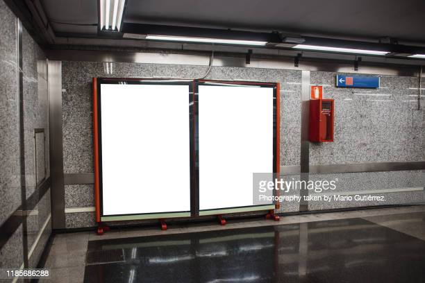 two blank billboards inside subway station - two objects stock pictures, royalty-free photos & images