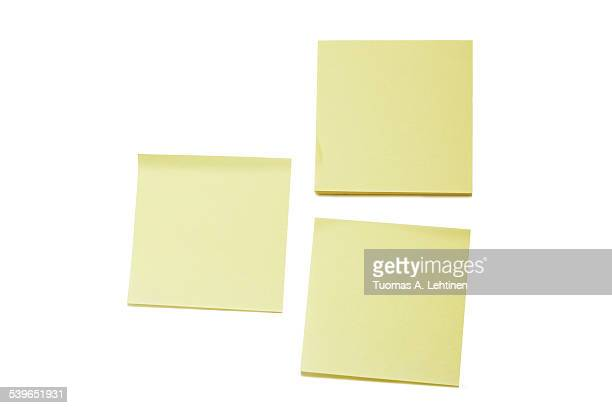 Two blank yellow post-it notes and a stack