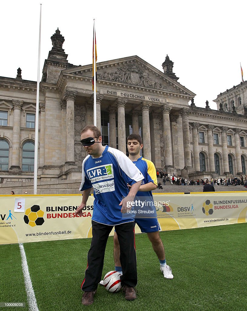 Two blind football players warm up prior to the Blind Football National match between Germany and Turkey on the �Day of Blind Football� in front of the Reichstag on May 20, 2010 in Berlin, Germany.