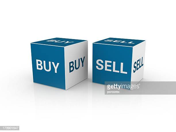 Two blue and white cubes with BUY and SELL written on them