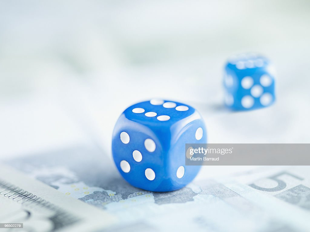 Two blue dice on pile of euro notes : Stock Photo