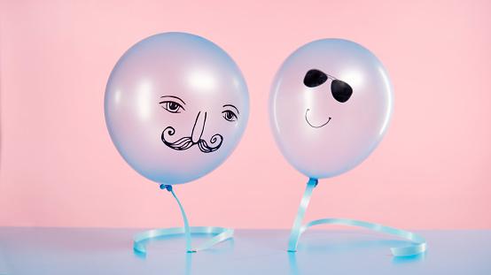 two blue helium balloons with smiling faces floating - gettyimageskorea