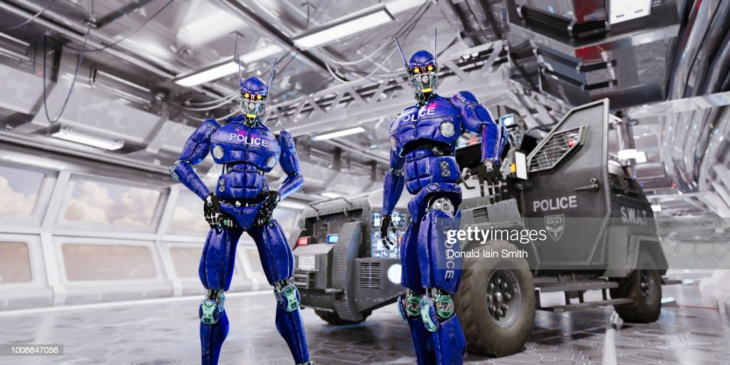 Two blue police robots with swat vehicle in futuristic traffic tunnel : Stock Photo