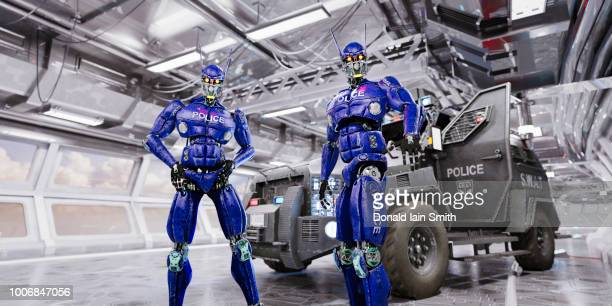 two blue police robots with swat vehicle in futuristic traffic tunnel - national security commission on artificial intelligence stock photos and pictures