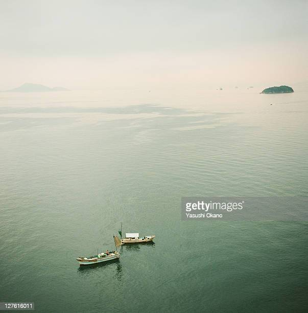 Two boats floating on sea