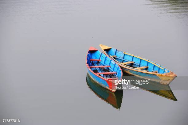 Two Boats Floating On Water