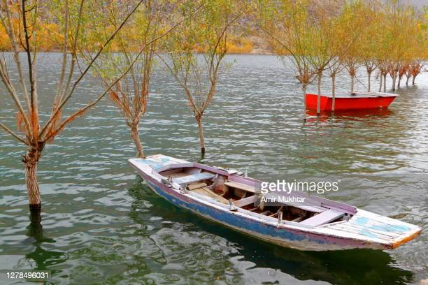 two boats in a lake in autumn season. - skardu stock pictures, royalty-free photos & images