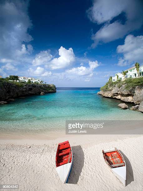 Two boats on a beach in Curacao.