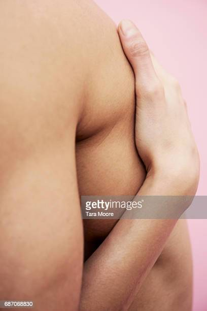 two bodies hugging - male torso stock photos and pictures