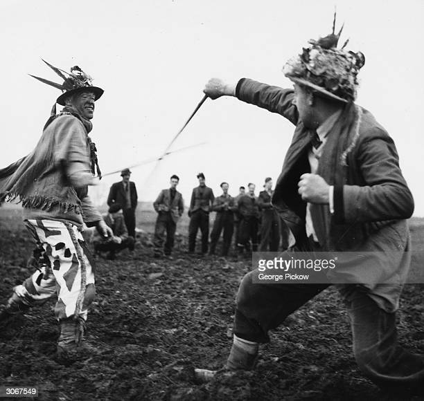 Two boggans fighting each other during the traditional Boxing Day ceremony at Haxey in Lincolnshire circa 1955