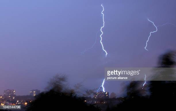 Two bolts of lightning are visible in the night sky during a thunderstorm in Stuttgart Germany 20 June 2013 PhotoChristoph Schmidt | usage worldwide