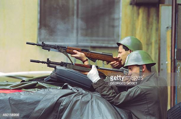Two Bosnian fighters aim their riffles at Serbian irregulars positions during heavy fightings in the western suburbs of Sarajevo on June 09 1992...