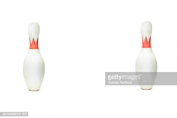Two bowling pins on white background