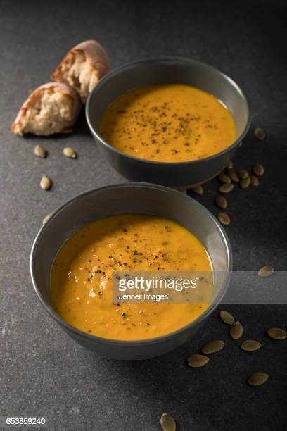 Two Bowls Of Carrot And Coriander Soup.