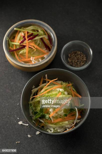 two bowls of fresh salad. - black seed oil stock pictures, royalty-free photos & images
