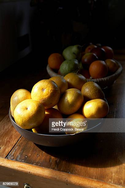 two bowls of fruit , still life. - heidi coppock beard stockfoto's en -beelden