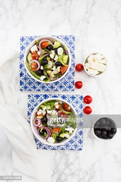 Two bowls of Greek salad