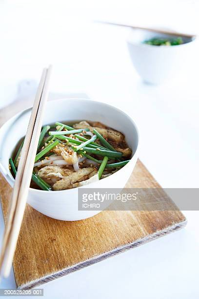Two bowls of udon with chopsticks, elevated view