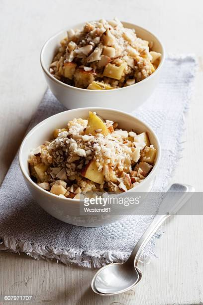 Two bowls of vegan quinoa porridge with apple and pecan