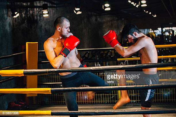 Two boxers fighting in boxing from behind ropes