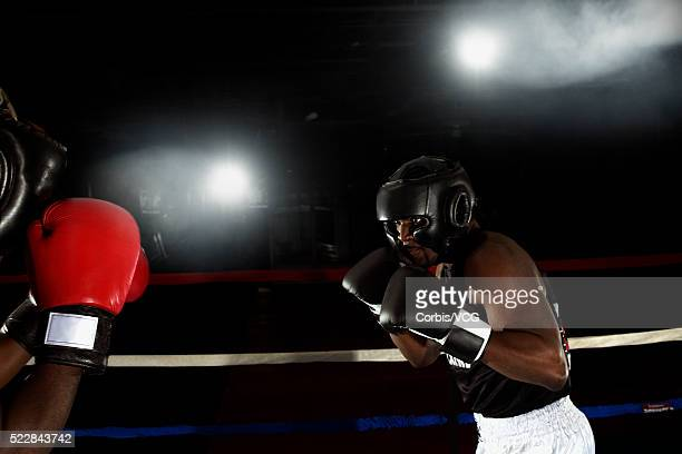 Two boxers fighting in the ring