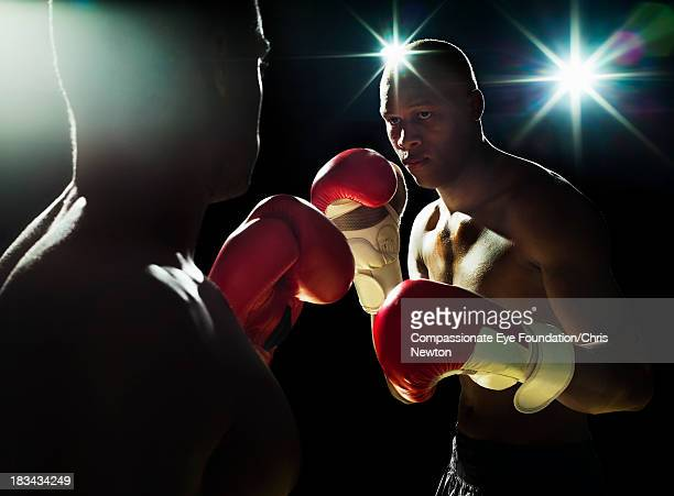 two boxers fighting - boxing stock pictures, royalty-free photos & images