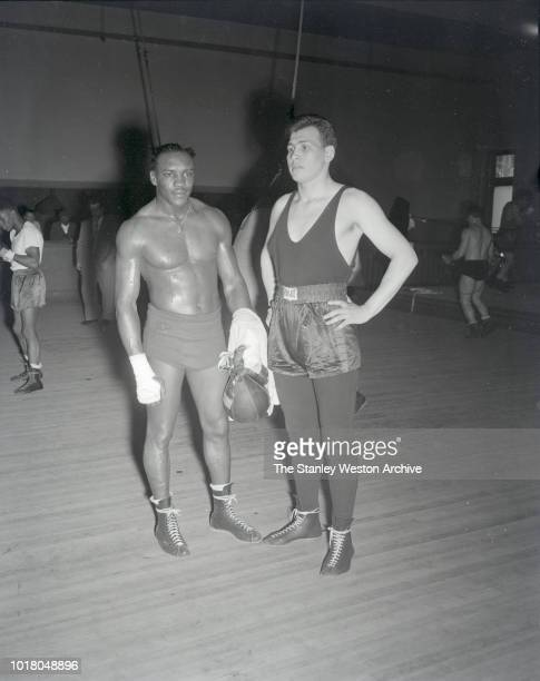 Two boxers pose for a portrait in Stillman's Gym circa 1955 in New York City New York