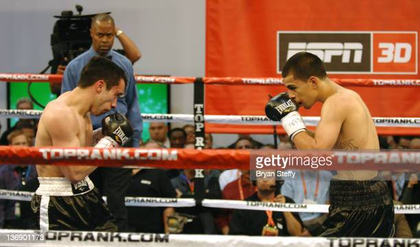 Two boxers sparr live in the boxing ring in the ESPN 3D section at the 2012 International Consumer Electronics Show at the Las Vegas Convention...