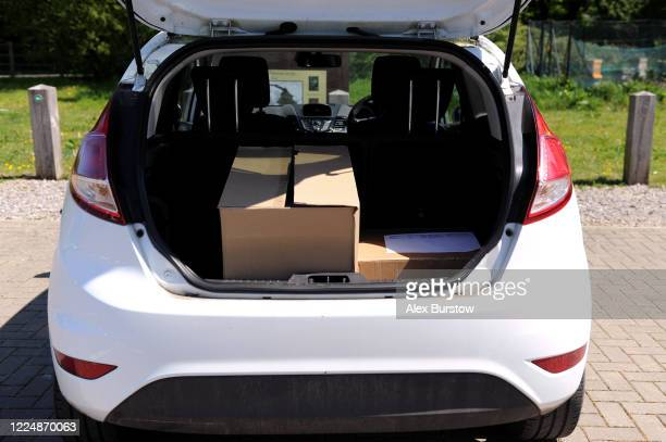 Two boxes of fullface visors are seen in the back of a car as they are collected from the Church Crookham and Fleet Men's Shed to be distributed to...
