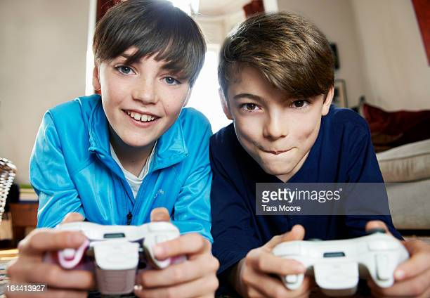 two boy playing with video games console - boys stock pictures, royalty-free photos & images