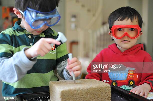 Two boy with fossils with safety glasses