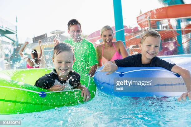 Two boys and family having fun at water park
