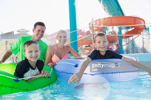 Two boys and parents having fun at water park