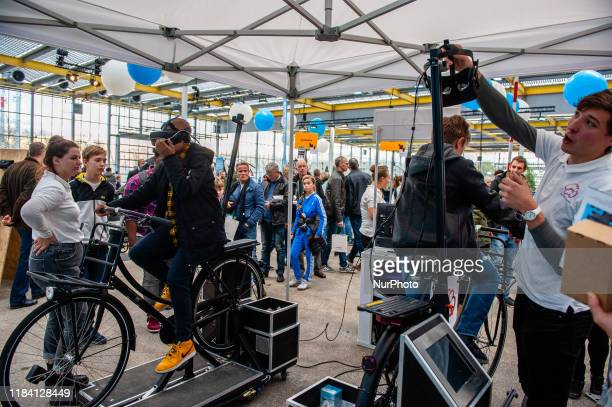 Two boys are trying static bikes during the Bright Day Festival in Amsterdam on November 23rd 2019