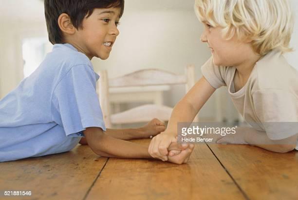 Two boys arm wrestling