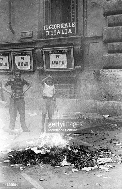 Two boys burning some copies of 'Giornale d'Italia' in corso Umberto during a demonstration for the fall of Fascism Rome 26th July 1943